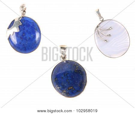 A Set Of Three Pendants Made Of Precious Gemstones, On White Studio Background.