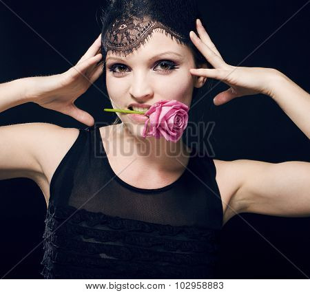 portrait of beauty young woman through lace with makeup and rose fairy