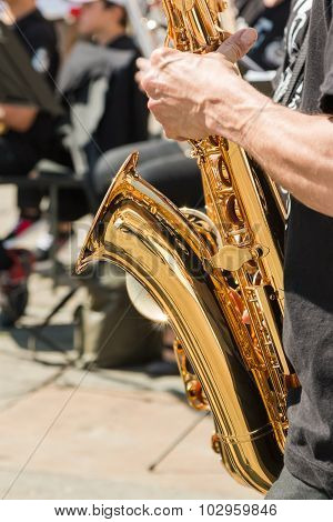 Playing Saxophone Instrument During Outdoor Concert
