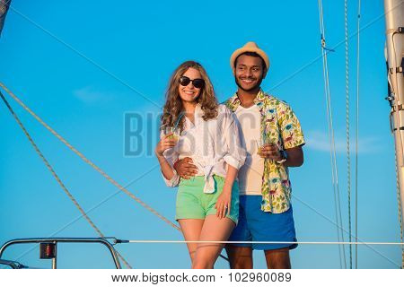 Loving couple relaxing on a yacht.