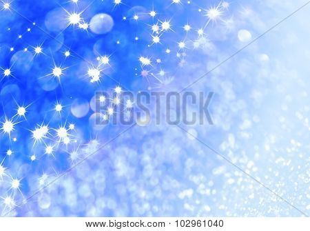 Blue defocused glitter background with copy space