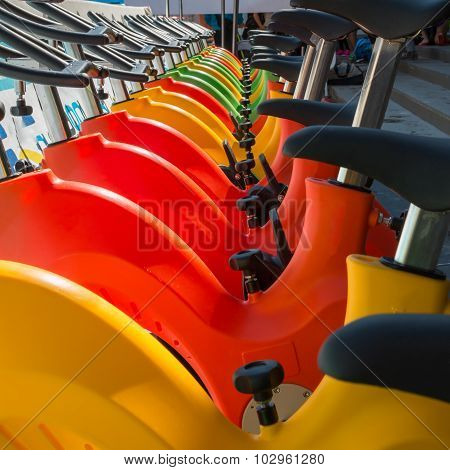Colorful Aquatic Bikes In Line, Designated For Swimming Pool