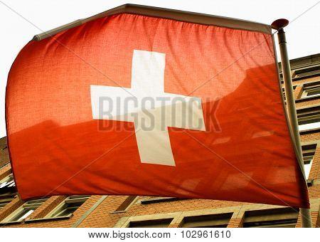 Waving Swiss Flag On The Wind