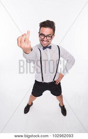 Smiling man showing middle finger