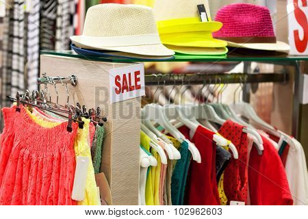 Dresses and hats in the shop