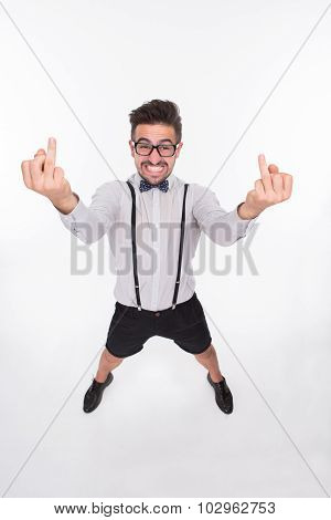 Smiling man showing middle finger