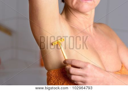 Middle Aged Woman Shaving Her Armpit