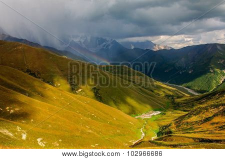 The storm in mountains, sunny valley.