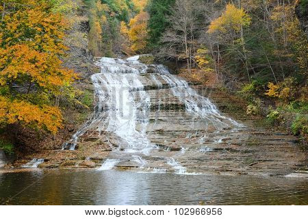 Autumn scene landscape of waterfalls at Buttermilk Falls State Park