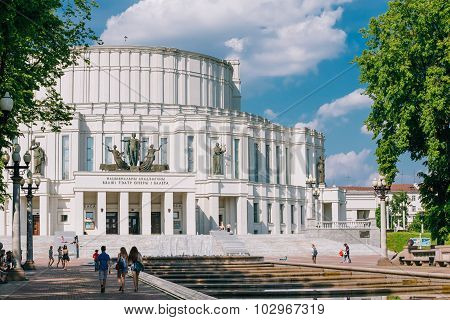 People walking in park near National Academic Bolshoi Opera and