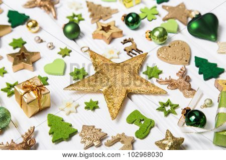 Festive christmas decoration in light green, white and golden color. Collection of xmas miniatures.