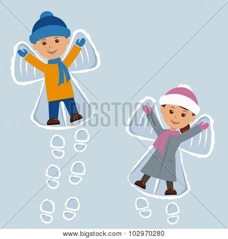 Children lying on snow as snow angels. New Year holidays