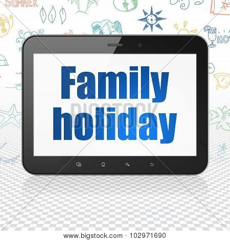 Vacation concept: Tablet Computer with Family Holiday on display
