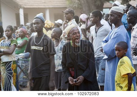 African Elder Laughing At A Political Rally
