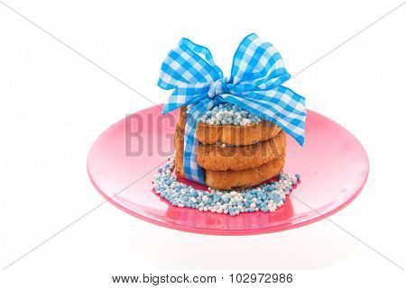 Dutch tradition with pink mice on biscuit while baby born isolated over white background