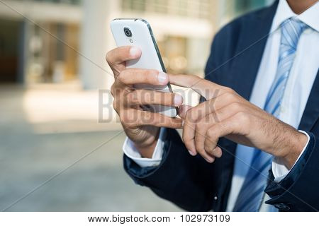 Close up of a man using his mobile smartphone