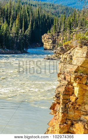 Majestic mountain river in Canada. Athabasca River, Banff, Alberta.