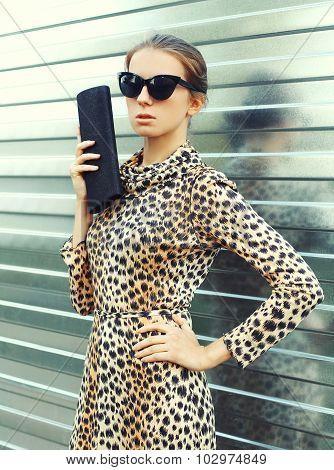 Fashion Portrait Pretty Woman In Sunglasses And Leopard Dress With Handbag Clutch