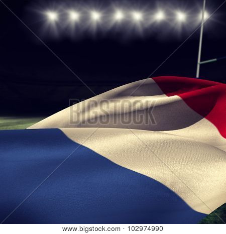 Low angle view of France flag against rugby stadium