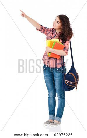 Smiling student girl with backpack and books showing something, isolated on white background