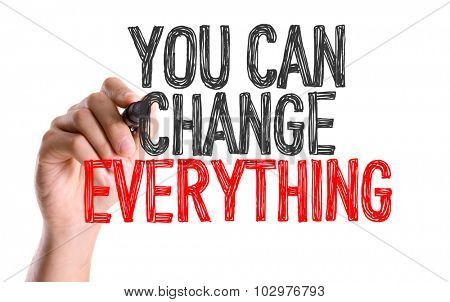 Hand with marker writing: You Can Change Everything