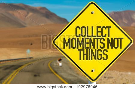 Collect Moments Not Things sign on desert road