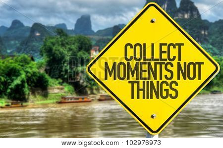 Collect Moments Not Things sign with exotic background
