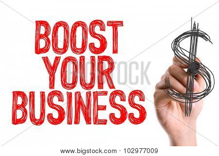 Hand with marker writing: Boost Your Business