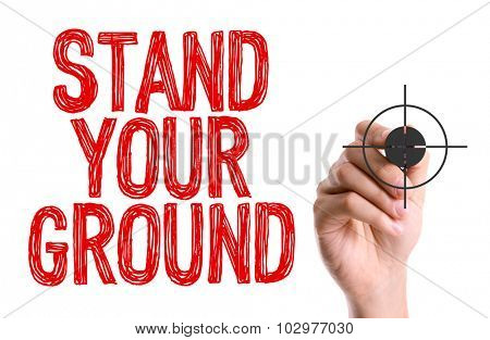 Hand with marker writing: Stand Your Ground