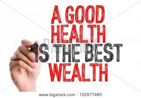 Hand with marker writing: A Good Health Is The Best Wealth
