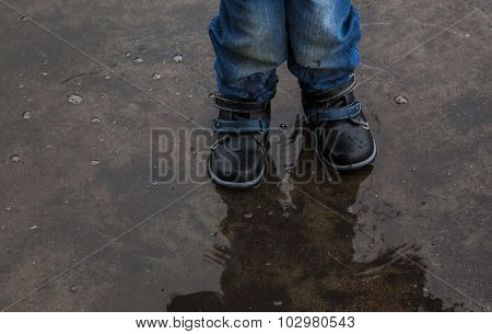 child in the puddle