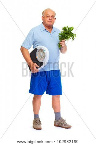 Senior man with scales and vegetables isolated over white background.