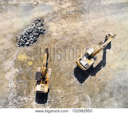 Aerial view of a excavators in the mine. Industrial background from landscape after mining.