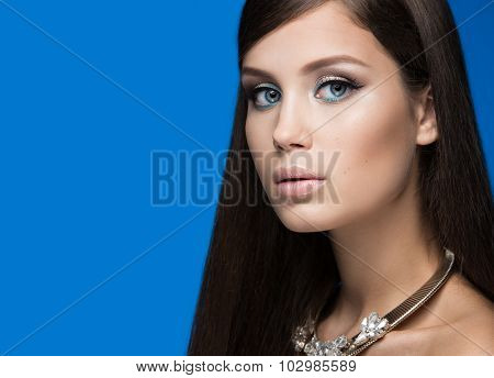 Beautiful woman with evening make-up and long straight hair . Smoky eyes. Fashion photo.