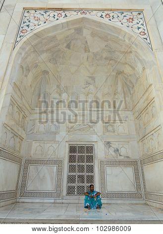 Indian Woman In Colorful Sari Sitting In Taj Mahal