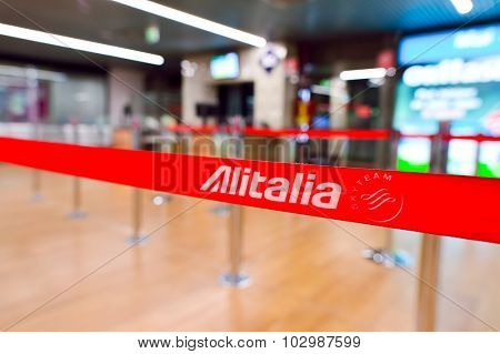 ROME, ITALY - AUGUST 16, 2015: close-up shot of Alitalia belt in Fiumicino Airport interior. Fiumicino - Leonardo da Vinci International Airport is a major international airport in Rome, Italy