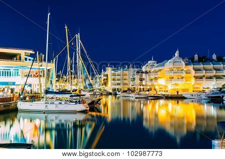 Night View of floating houses, vessel in Puerto Marina. Malaga r