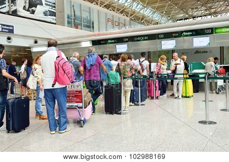 ROME, ITALY - AUGUST 16, 2015: passenger check-in area in FCO airport. Fiumicino - Leonardo da Vinci International Airport is a major international airport in Rome, Italy