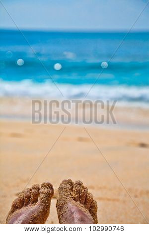 Vacation concept, Feet on a sand beach on a hot sunny sumer day
