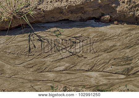 Dried land with drawing after flood rain in the field