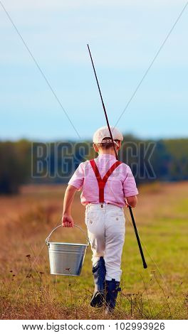 Rear View Of Cute Kid Walking For Fishing