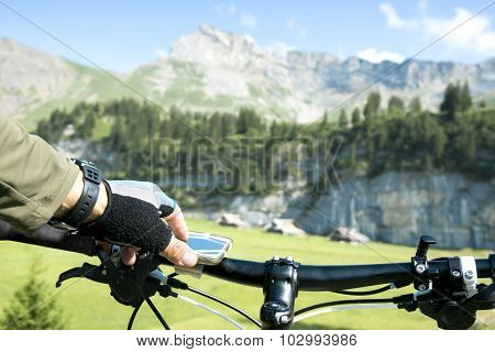 Bicycle Rider Navigates In Mountains