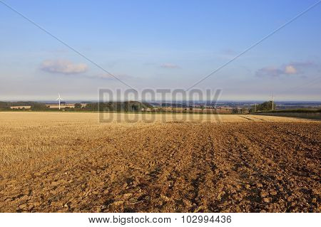 Agricultural Landscape With Wind Turbine