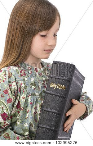 young child holding the bible