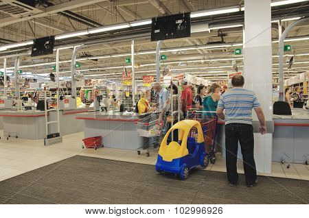 Customers on the cash-desk in the hypermarket Magnit