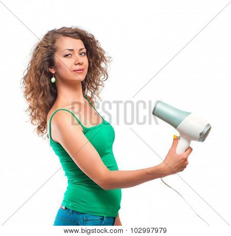Curly woman using hairdryer isolated