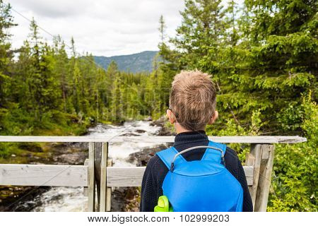 Child Outdoors In Nature