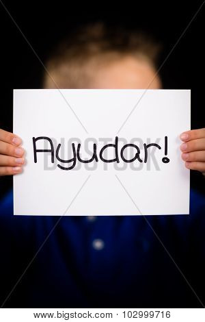 Child Holding Sign With Spanish Word Ayudar - Help
