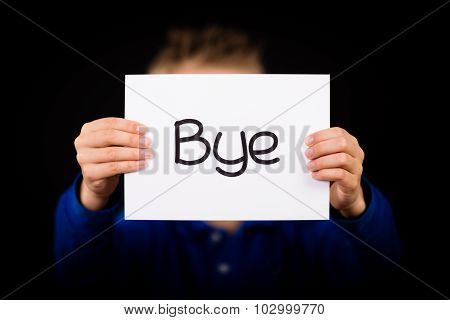 Child Holding Sign With Spanish Word Bye Which Means See You Later