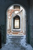 picture of fornication  - archway in the abandoned building and snowy stairs  - JPG